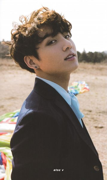Tags: K-Pop, BTS, Jungkook, Close Up, Outdoors, Black Eyes, Wavy Hair, Grass, Blue Shirt, Hot Air Balloon, Tree, Scan