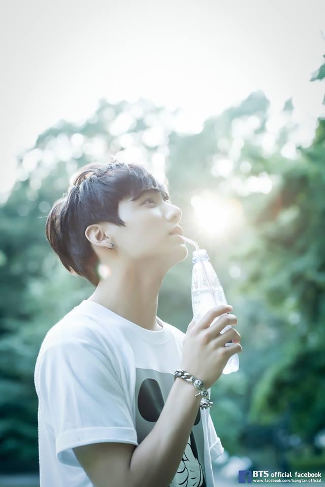 Tags: K-Pop, BTS, Jungkook, Bracelet, Black Eyes, Straw, Looking Up, Plant, Bottle, Water, Tree, Side View