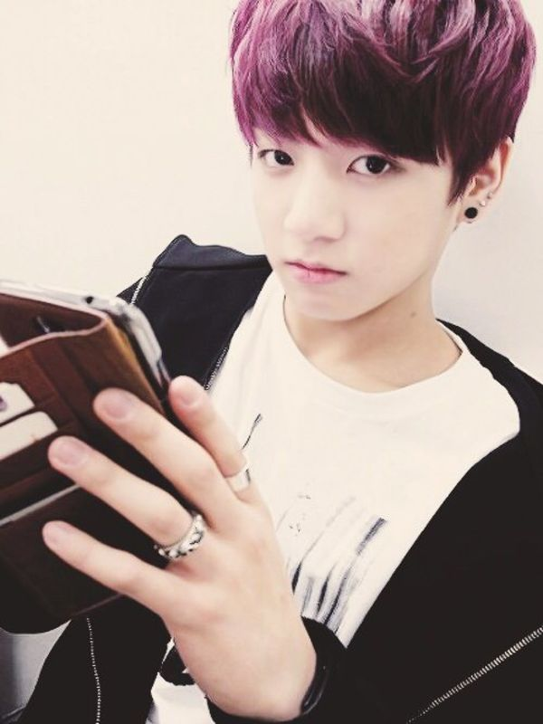 Tags: K-Pop, Bangtan Boys, Jungkook, Smartphone, Purple Hair, Hood, Black Eyes, Hoodie, Phone, Ring, Serious