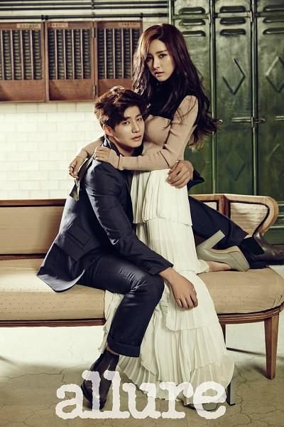 Tags: K-Drama, Song Jae-rim, Kim So-eun, Brown Shirt, Ring, White Skirt, Hug, Holding Close, Couch, Duo, Couple, Black Pants
