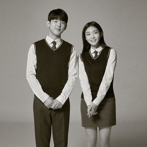 Tags: K-Pop, Kim Chung-ha, Paul Kim, Gray Neckwear, Tie, Bare Legs, Matching Outfit, Skirt, Vest, School Uniform, Gray Pants, Duo