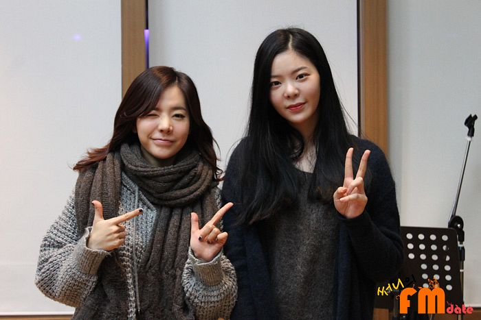 Tags: K-Pop, Girls' Generation, Jang Jae-in, Sunny, Black Jacket, Text: Series Name, Scarf, Pointing, Duo, Wink, Gray Jacket, Gray Background