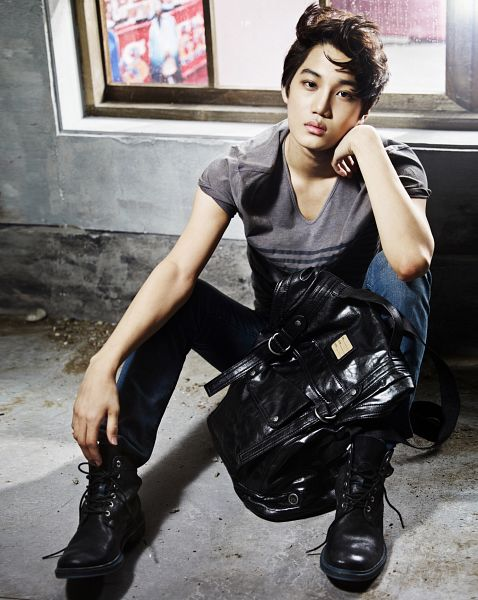 Tags: K-Pop, EXO, Kai, Black Footwear, Boots, Gray Shirt, Bent Knees, Sitting, Bag, Pants, Shoes, Gray Background