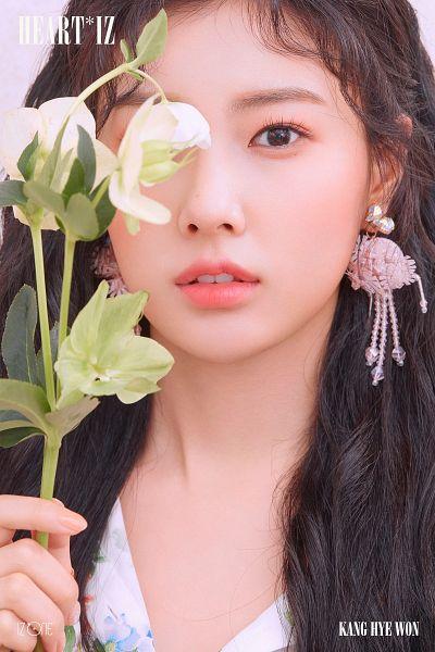 Tags: K-Pop, IZ*ONE, Kang Hyewon, White Flower, Text: Album Name, Flower, Pink Background, Make Up, Text: Artist Name, Blush (Make Up)