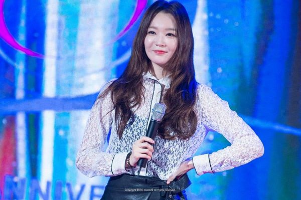 Tags: K-Pop, Davichi, Kang Minkyung, Bow, Black Skirt, Black Bow, Hand On Hip, Looking Ahead, Skirt, See Through Clothes, Blue Background, Leather Skirt