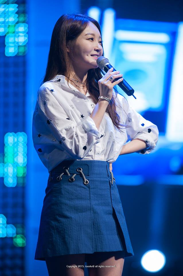 Tags: K-Pop, Davichi, Kang Minkyung, Denim Skirt, Hand On Hip, Bare Legs, Necklace, Looking Ahead, Bracelet, Blue Background, Skirt, Toodur2