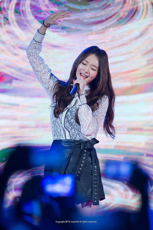 Tags: K-Pop, Davichi, Kang Minkyung, Bare Legs, Eyes Closed, Singing, Bracelet, See Through Clothes, Black Bow, Skirt, Leather Skirt, Multi-colored Background