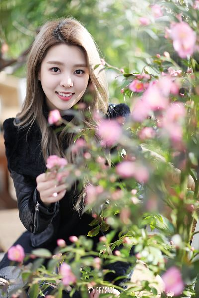 Tags: K-Pop, Berry Good, Kang Sehyung, Pink Flower, Coat, Bush, Flower, Plant, Teeth, Grin, Standing, Android/iPhone Wallpaper
