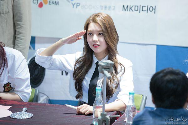 Tags: K-Pop, Berry Good, Kang Sehyung, Tie, Pen, Skirt, White Skirt, Bent Knees, Bottle, Sitting, Salute, Wavy Hair