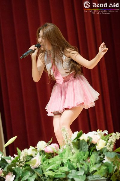 Tags: K-Pop, Berry Good, Kang Sehyung, Sleeveless Shirt, Pink Skirt, Sleeveless, Pink Neckwear, Microphone, Curtain, Tie, Bare Shoulders, Black Eyes