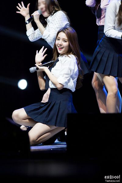 Tags: K-Pop, Berry Good, Kang Sehyung, Skirt, Stage, Black Skirt, Grin, Kneeling, Black Eyes, Microphone, Rolled Up Sleeves