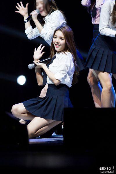 Tags: K-Pop, Berry Good, Kang Sehyung, Microphone, Stage, Teeth, Skirt, Black Skirt, Grin, Black Eyes, Kneeling, Rolled Up Sleeves