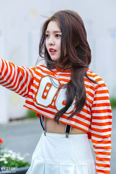 Tags: K-Pop, Berry Good, Kang Sehyung, Wavy Hair, Flowing Hair, Skirt, Text: URL, Striped, Looking Ahead, Striped Shirt, Wind, White Skirt