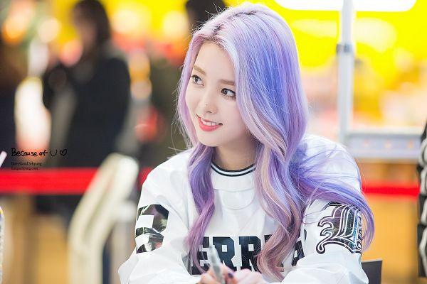 Tags: K-Pop, Berry Good, Kang Sehyung, Teeth, Looking Away, Purple Hair, Make Up, Bent Knees, Black Eyes, Grin, Nail Polish, Sitting