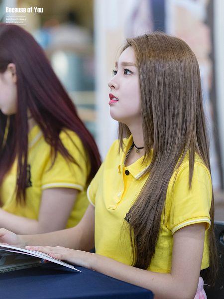 Tags: K-Pop, Berry Good, Kang Sehyung, Short Sleeves, Table, Looking Up, Black Eyes, Open Book, Yellow Shirt, Sad, Bent Knees, Choker