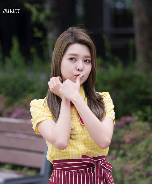 Tags: K-Pop, Berry Good, Kang Sehyung, Yellow Shirt, Apron, Finger To Lips, Bow, Looking Away, Striped, Short Sleeves, Wind, Red Bow