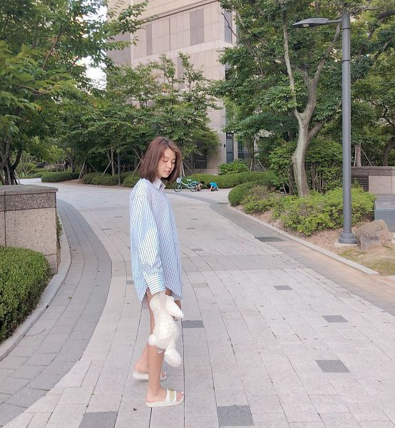 Tags: K-Pop, Berry Good, Kang Sehyung, Medium Hair, Plant, Stuffed Toy, Shoes, Striped, Blue Shirt, Road, Looking Down, Slippers