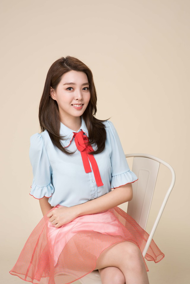 Tags: K-Pop, Berry Good, Kang Sehyung, Sitting On Chair, Crossed Legs, Short Sleeves, Skirt, Red Bow, Blue Shirt, Chair, Pink Skirt, Brown Background