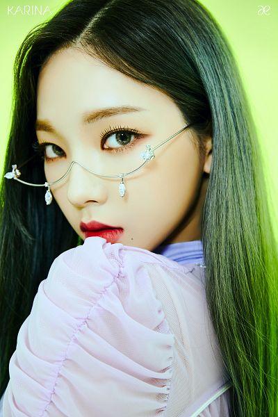 Tags: K-Pop, Aespa, Karina, Glasses, Text: Artist Name, Green Background