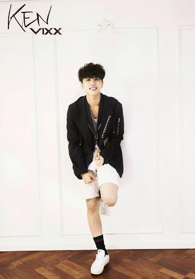 Tags: K-Pop, VIXX, Ken, Light Background, Text: Artist Name, Leaning On Wall, Black Legwear, White Background, Black Outerwear, Shoes, Full Body, White Footwear