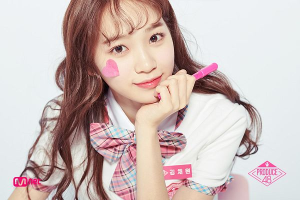 Tags: Television Show, K-Pop, Kim Chaewon, Blunt Bangs, Light Background, Text: Artist Name, Chin In Hand, White Background, Pen, Holding Object, Checkered Neckwear, Bow Tie