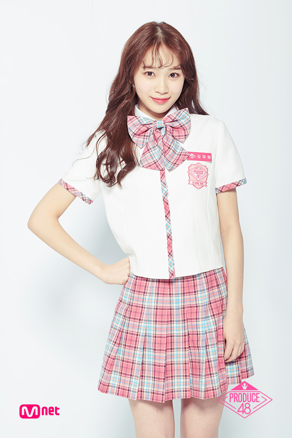 Tags: K-Pop, Television Show, Kim Chaewon, Pink Skirt, Light Background, Text: Artist Name, Short Sleeves, Checkered Neckwear, White Background, Checkered Skirt, Text: Series Name, Hand On Hip