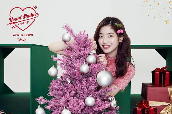 Tags: JYP Entertainment, K-Pop, Twice, Kim Dahyun, Short Sleeves, Text: Artist Name, Christmas, Text: Song Title, Pink Shirt, Light Background, Christmas Tree, Tree
