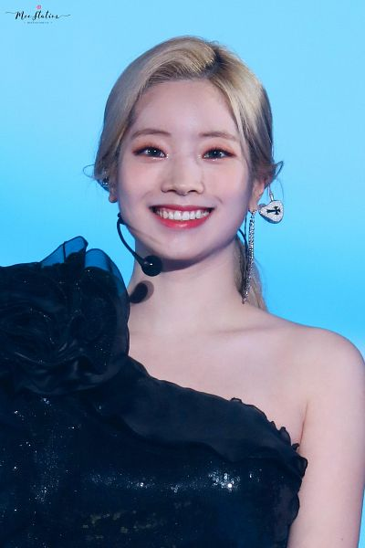 Tags: K-Pop, Twice, Kim Dahyun, Hair Up, Gray Eyes, Make Up, Ponytail, Blue Background, Black Dress, Bare Shoulders, Black Outfit, Looking Ahead