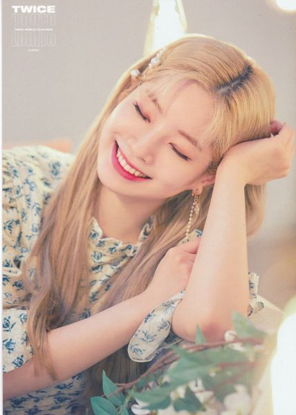 Tags: K-Pop, Twice, Kim Dahyun, Hand In Hair, Floral Print, Light Background, Text: Artist Name, White Background, Hand On Arm, Eyes Closed, Hair Ornament, Floral Shirt