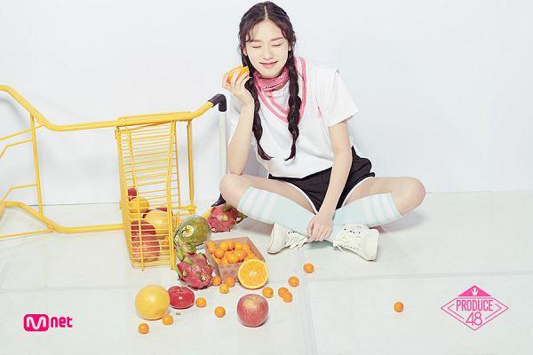 Tags: Television Show, K-Pop, Kim Doah, Dragon Fruit, Apple, Braids, Text: Series Name, Twin Braids, Shopping Cart, Fruits, Eyes Closed, Scarf