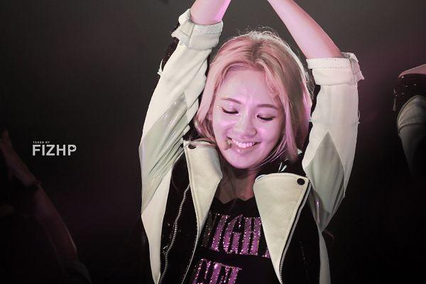 Tags: K-Pop, Girls' Generation, Kim Hyo-yeon, Kwon Yuri, Dark Background, Blonde Hair, Arms Up, Eyes Closed, Black Background, Green Outerwear, Black Shirt, Wallpaper