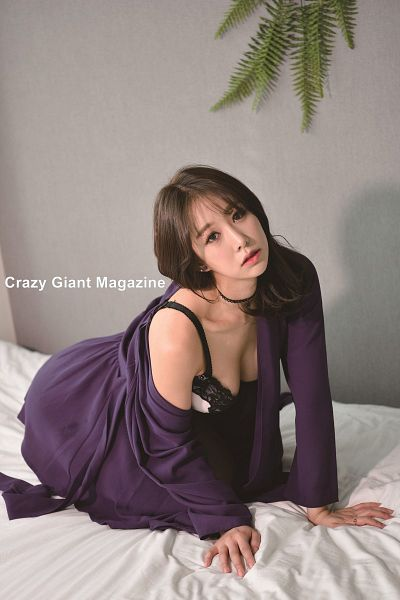 Tags: K-Pop, ICIA, Kim Hyogyeong, Crouching, Purple Outerwear, Bra, Plant, Gray Background, Suggestive, Text: Magazine Name, Purple Jacket, Bed
