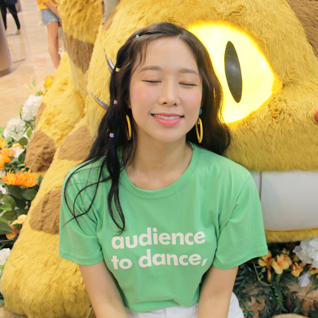 Tags: K-Pop, ICIA, Kim Hyogyeong, Hair Ornament, English Text, Stuffed Animal, Eyes Closed, Green Shirt, Stuffed Toy, Short Sleeves