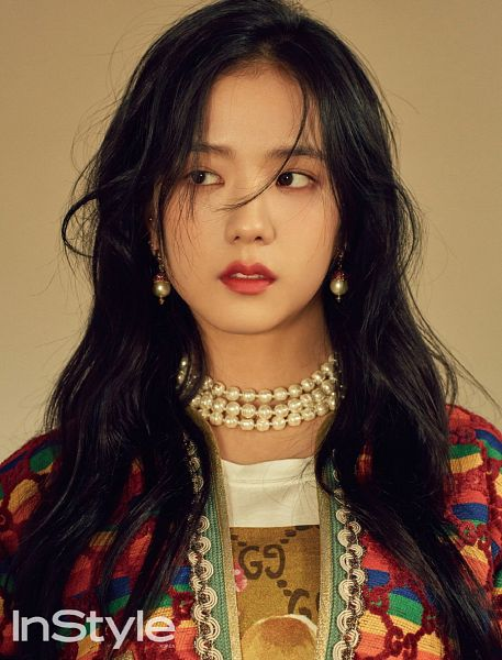Tags: K-Pop, Black Pink, Kim Jisoo, Close Up, Brown Background, English Text, Looking Away, Multi-colored Jacket, Text: Magazine Name, Necklace, InStyle