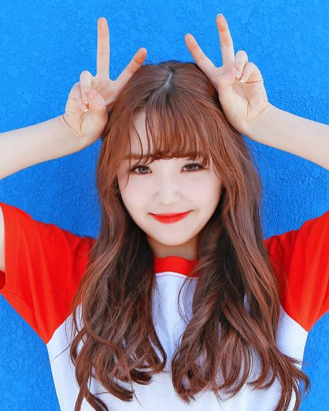 Tags: K-Pop, Busters, Kim Minji (Busters), Blue Background, Red Hair, Closed Mouth, Wavy Hair, Arms Up, Bangs, Short Sleeves, V Gesture