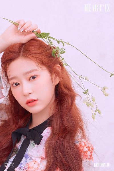 Tags: K-Pop, IZ*ONE, Kim Minju, Text: Artist Name, Black Bow, Wavy Hair, Floral Dress, Pink Background, Red Hair, White Flower, Make Up, One Arm Up