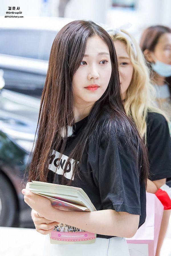 Tags: K-Pop, Momoland, Kim Nayun, Text: Artist Name, Shorts, White Shorts, Outdoors, Book, Looking Away