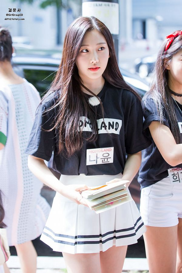 Tags: K-Pop, Momoland, Kim Nayun, Outdoors, Bare Legs, Looking Away, White Shorts, Shorts, White Skirt, Skirt, Text: Artist Name, Black Shirt