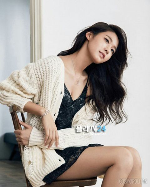 Tags: K-Pop, AOA (Ace Of Angels), Kim Seolhyun, Black Dress, Text: Magazine Name, Chair, Sitting On Chair, Sleeveless Dress, Cardigan, Black Outfit, Bare Shoulders, Sleeveless