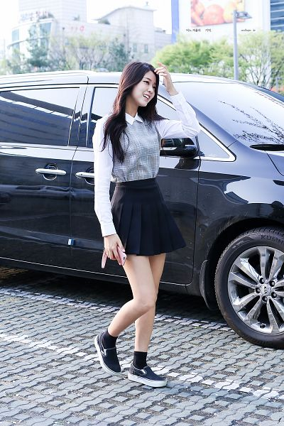 Tags: K-Pop, AOA (Ace Of Angels), Kim Seolhyun, Phone, Black Skirt, Black Footwear, Hand In Hair, Pleated Skirt, Korean Text, Outdoors, Socks, Bare Legs
