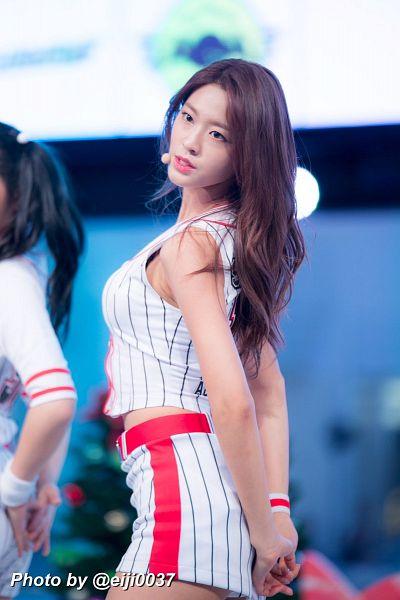 Tags: K-Pop, AOA (Ace Of Angels), Kim Seolhyun, Sleeveless, Bare Shoulders, White Skirt, Belt, Sleeveless Shirt, Skirt, Bare Legs, Striped Shirt, Arms Behind Back