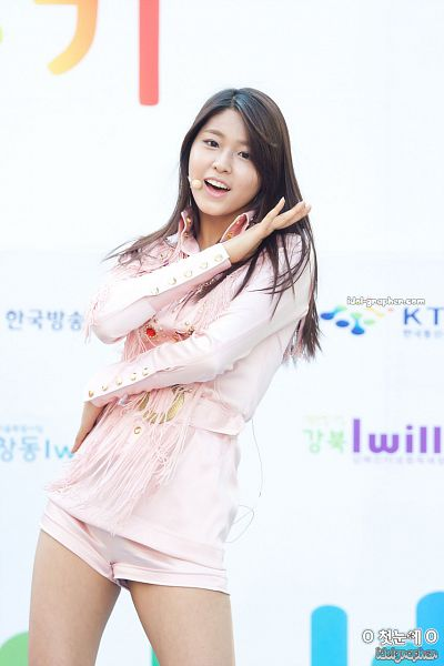 Tags: K-Pop, AOA (Ace Of Angels), Kim Seolhyun, Pink Shirt, Shorts, Pink Shorts, Belt, Bare Legs, Light Background, White Background, Hand On Shoulder, Hand On Hip