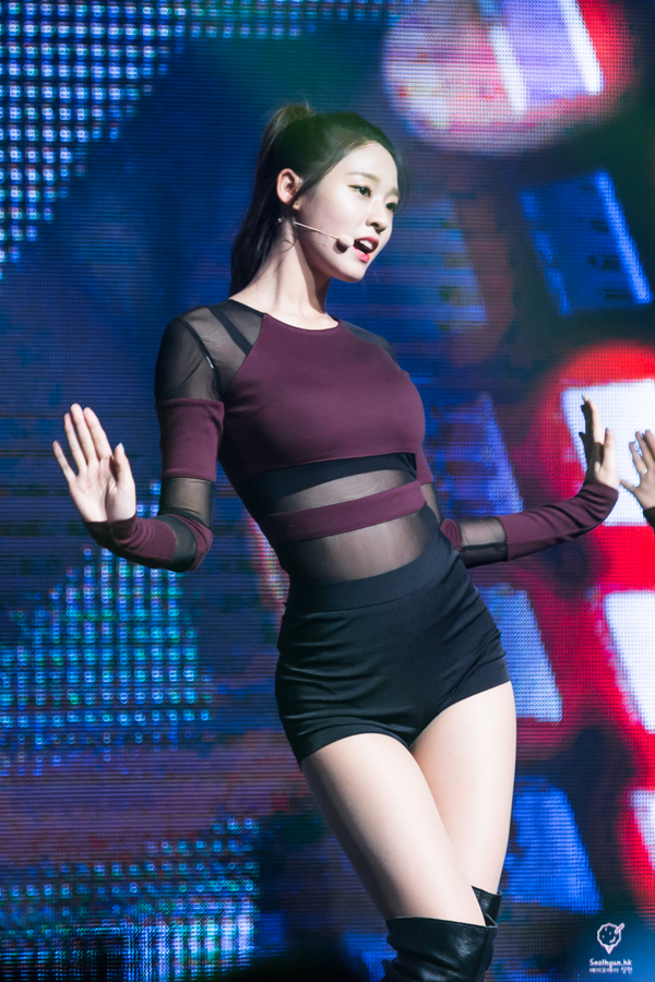 Tags: K-Pop, AOA (Ace Of Angels), Kim Seolhyun, Purple Shirt, Knee Boots, Fishnets, Arms Out, Boots, Black Footwear, Hair Up, Black Shorts, Ponytail