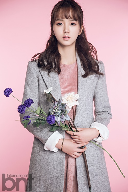 Tags: K-Drama, Kim So-hyun, Text: Magazine Name, Flower, Gray Jacket, Pink Background, White Flower, Pink Outfit, Purple Flower, Pink Dress, Gray Outerwear, International Bnt