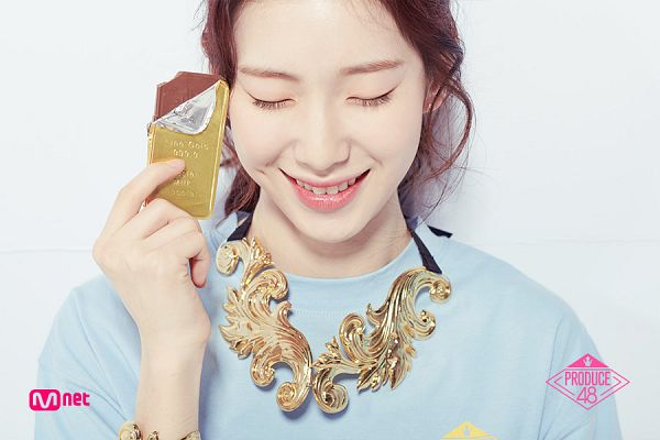 Tags: Television Show, K-Pop, Chocolat, Kim Suyun, Ponytail, Text: Series Name, Blue Shirt, Light Background, Sweets, White Background, Chocolate, Holding Object