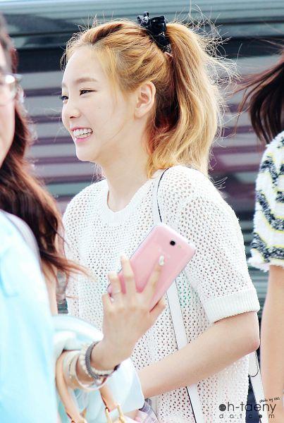 Tags: K-Pop, Girls' Generation, Kim Tae-yeon, Black Headwear, Ponytail, Looking Ahead, Eyes Half Closed, See Through Clothes, Hair Up, Oh-taeny