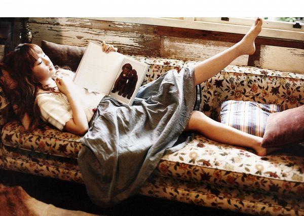 Tags: K-Pop, Girls' Generation, Kim Tae-yeon, Barefoot, Reading, Dog, Gray Skirt, Animal, Couch, Book, Skirt, Eyes Half Closed