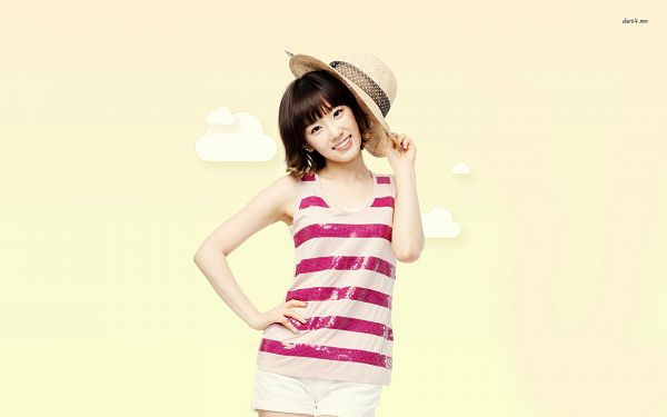 Tags: K-Pop, Girls' Generation, Kim Tae-yeon, White Shorts, Yellow Background, Hand On Hip, Laughing, Shorts, Pink Shirt, Medium Hair, Brown Headwear, Hat