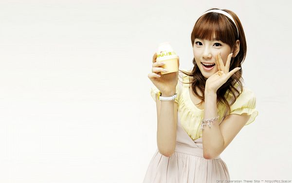 Tags: K-Pop, Girls' Generation, Kim Tae-yeon, White Outfit, White Dress, Hairband, Holding Object, Laughing, Sweets, Wavy Hair, Yellow Shirt, White Background