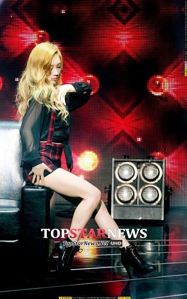 Tags: K-Pop, Girls' Generation, Kim Tae-yeon, Wavy Hair, Black Footwear, Sitting On Couch, Checkered Shorts, Shorts, Hand On Chest, Full Body, Red Shorts, Couch